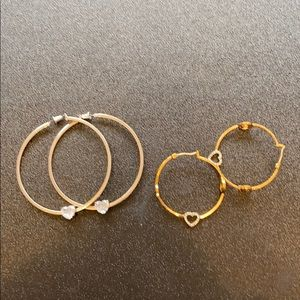 Two pairs of juicy couture hoops